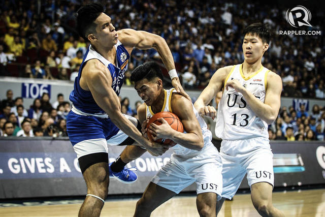 MIGHTY EAGLES. Thirdy Ravena and the Ateneo Blue Eagles hold off Mark Nonoy and the UST Growling Tigers in the title series. Photo by Josh Albelda/Rappler