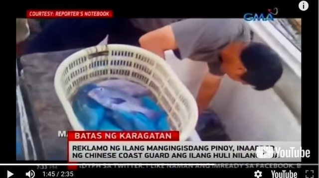 EFFECTIVE CONTROL? A video obtained by GMA News shows a male Chinese taking the catch of Filipino fishermen in Scarborough Shoal. Screenshot of a report on 24 Oras