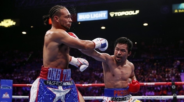 Pacquiao dethrones Thurman for WBA super welter crown