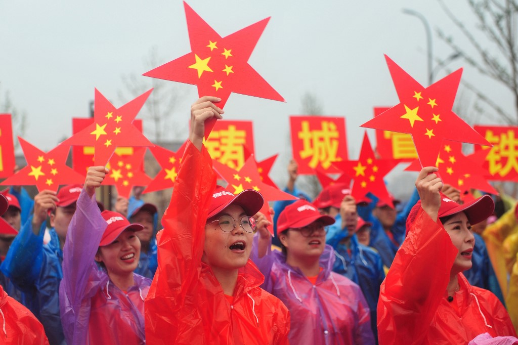 CHINA RISING. This photo taken on September 15, 2019 shows people singing a patriotic song during an event in Hangzhou in China's eastern Zhejiang province, to celebrate the 70th year of the founding of the People's Republic of China. AFP file photo