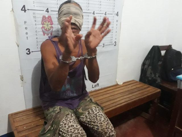 ARRESTED. Boy Hamja is arrested by Basilan police on September 5, 2017. Photo by Richard Falcatan/Rappler.