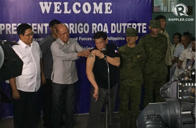 Duterte shows rose tattoo amid calls to see paolo 39 s for Chinese triad tattoo