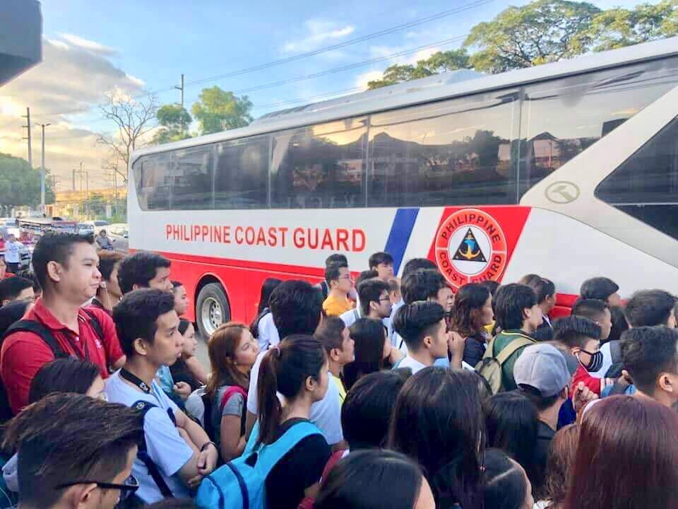 THE PHILIPPINE COAST GUARD deploys buses to transport commuters who normally take the LRT2 stations now shut down by fire. Photo from DOTr
