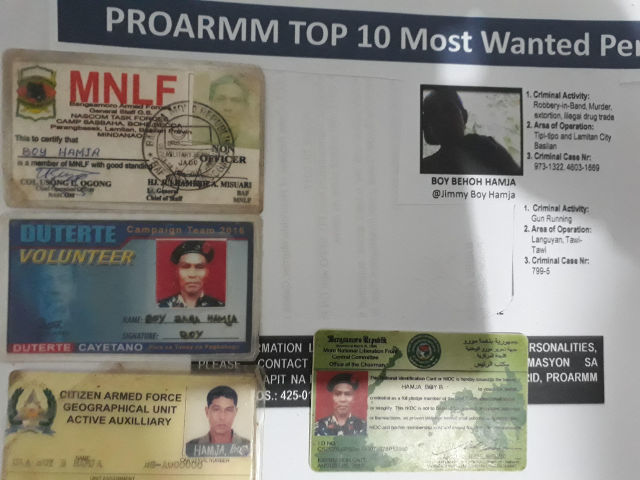 MOST WANTED. Identification cards for Boy Hamja. Photo by Richard Falcatan/Rappler.