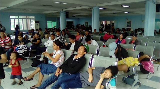 LONG WAIT. Passengers at the Tabaco port in Albay. Photo from the Philippine Coast Guard