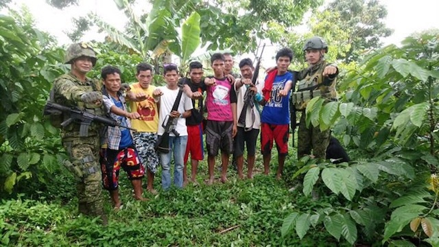 SURRENDER. This military handout photo shows 8 reported members of the NPA surrendering to the military in Sultan Kudarat