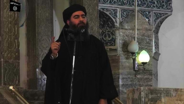 ISIS CHIEF. An image grab taken from a propaganda video released on July 5, 2014 by al-Furqan Media allegedly shows the leader of the Islamic State jihadist group, Abu Bakr al-Baghdadi, aka Caliph Ibrahim, addressing Muslim worshippers at a mosque in the militant-held northern Iraqi city of Mosul. File photo by AFP/Ho/Al-Furqan Media