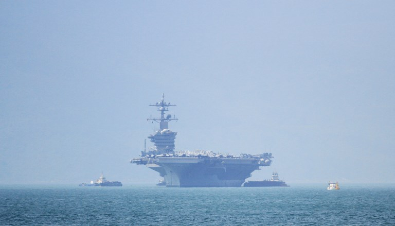 HISTORIC. The USS Carl Vinson (CVN-70), the US Navy's nuclear-powered Nimitz-class aircraft carrier, pulls into port in Danang on March 5, 2018.  Photo by Chan Nhu / AFP