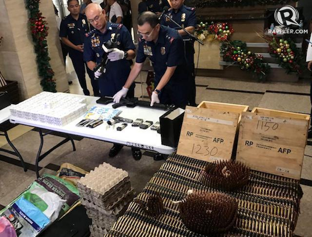 SMUGGLED FROM WITHIN? The confiscated bullets and guns, linked to the military, are presented in Camp Crame on December 17. Photo by Rambo Talabong/Rappler