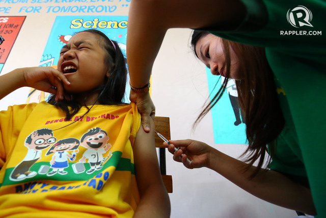 SCHOOL-BASED IMMUNIZATION. A student from Parang Elementary School gets a shot of Dengvaxia, the world's first-ever dengue vaccine. File photo by Ben Nabong/Rappler