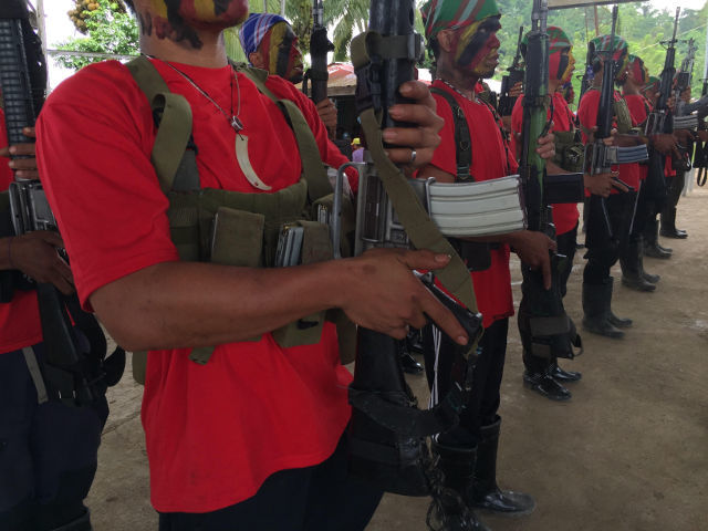 PEACE TALKS. This file photo shows members of the New People'€™s Army in Maco, Compostela Valley. File photo by Mick Basa
