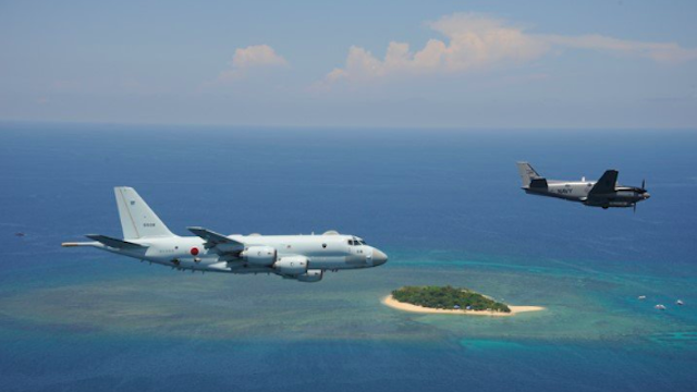 ENEMIES-TURNED-ALLIES. A P-1 patrol aircraft of the Japan Maritime Self Defense Force and a Beechcraft C-90 of the Philippine Navy fly over the West Philippine Sea for Exercise Balikatan 2018. Photo courtesy of JMSDF