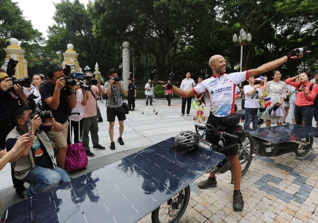 SOLAR BIKE RACE. Raf van Hulle of Belgium celebrates after arriving in Guangzhou, in China's southern Guangdong province, after riding 12,000 kilometers from Lyon, on August 3, 2018. Photo by AFP