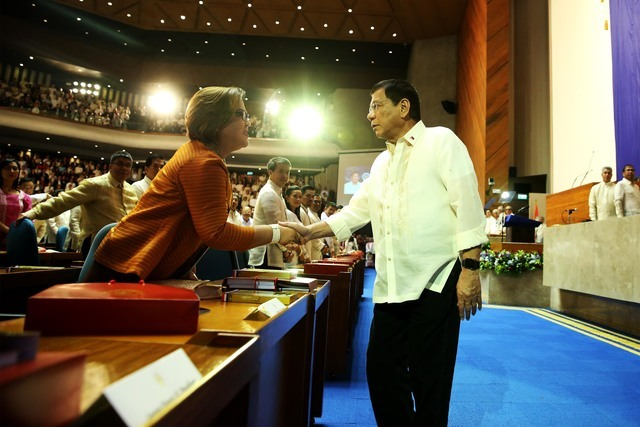 MEETING.President Rodrigo Duterte shakes hands with De Lima before delivering his 1st State of the Nation Address in 2016. The senator would not be able to attend his 2nd SONA. Malacañang file photo