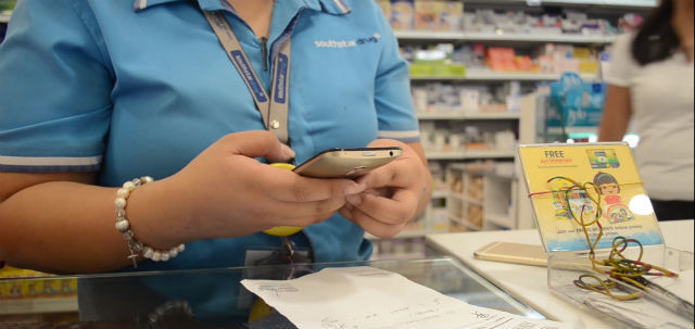 NEW TECHNOLOGY. A pharmacist takes a picture of a customer's prescription using the electronic Drug Safety System. Screenshot from mClinica