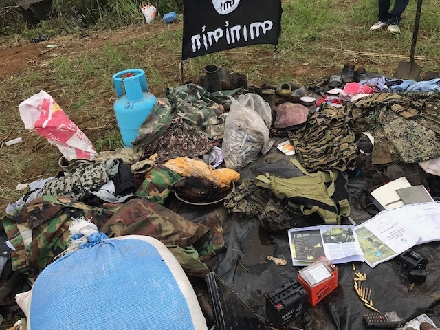 RECOVERED. Government forces seize items from a Maute encampment. Photo by Richard Falcatan/Rappler