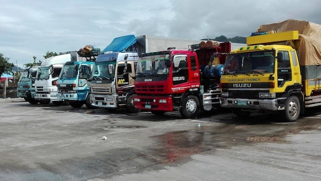 STRANDED CARGO. Trucks carrying cargo are not allowed to load at the Port of San Andres in Catanduanes. Photo from the Philippine Coast Guard