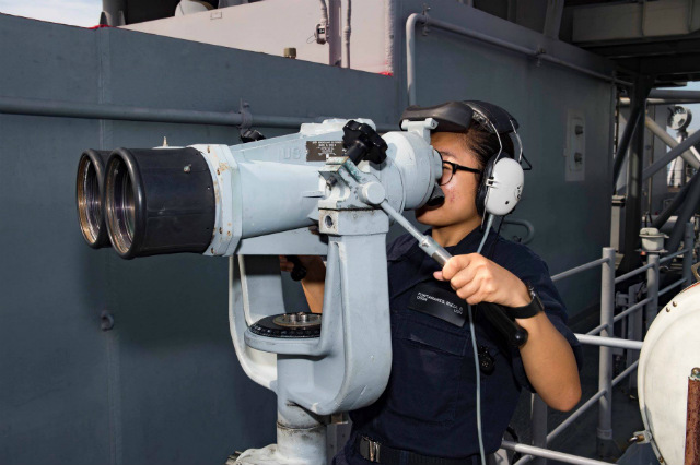 IN MANILA. Operations Specialist Seaman Recruit Rizza Fontanares, from San Diego, is on forward lookout watch as USS Bonhomme Richard arrives in the Philippines for a scheduled port visit. US Navy photo by Mass Communication Specialist 2nd Class William Sykes