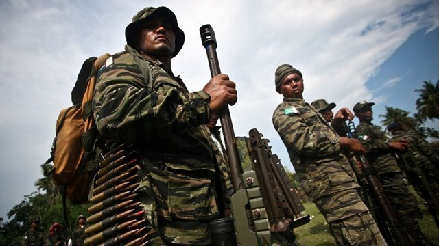 PEACE DEAL. In this photo taken on October 15, 2012 members of the Moro Islamic Liberation Front (MILF) stand in formation inside Camp Darapanan in Sultan Kudarat. File photo by Karlos Manlupig/AFP