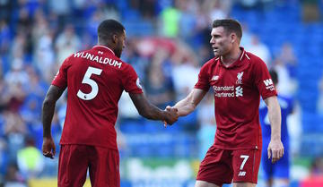 cb9e4c6de Geoginio Wijnaldum (left) and James Miller net in goals for Liverpool s