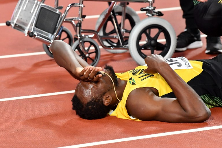 Sad farewell for injured Bolt as Britain wins 4x100m relay