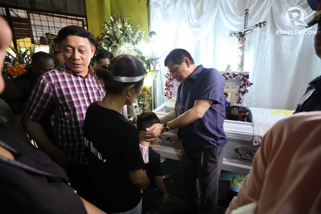 CONDOLENCES. President Rodrigo Duterte condoles with Jun Hilario, son of the late SPO1 Junior Hilario. Presidential photo