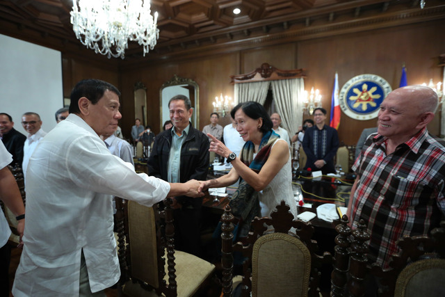 BETTER DAYS. President Rodrigo Duterte shares a light moment with NDF member Wilma Tiamzon in September 2016. Presidential photo