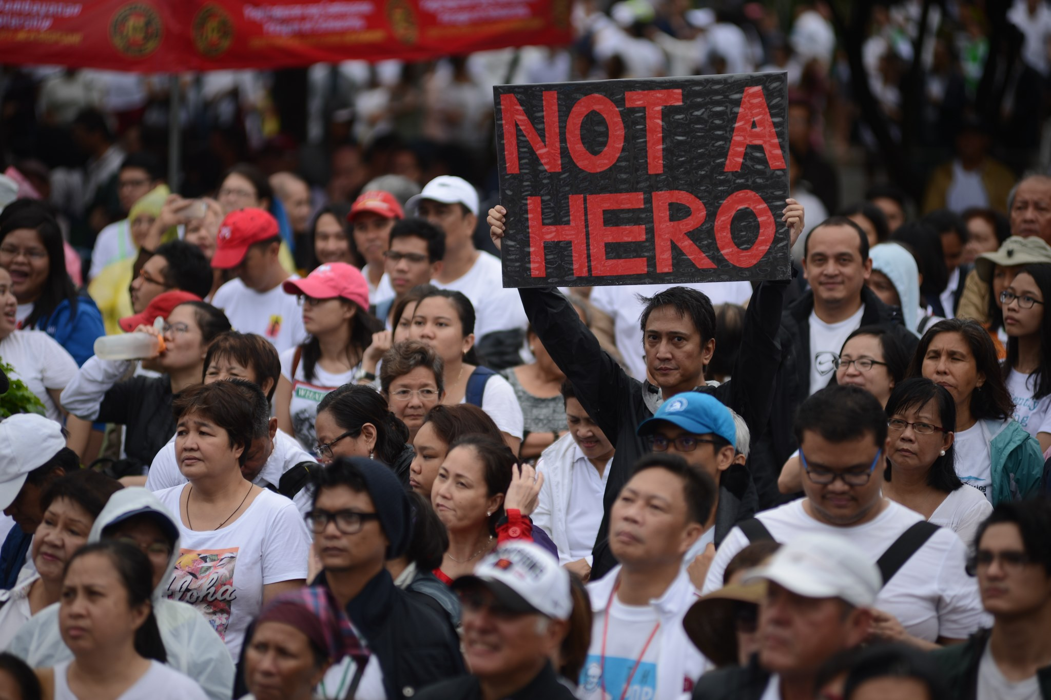 Nude students, activists protest dictator Marcoss burial