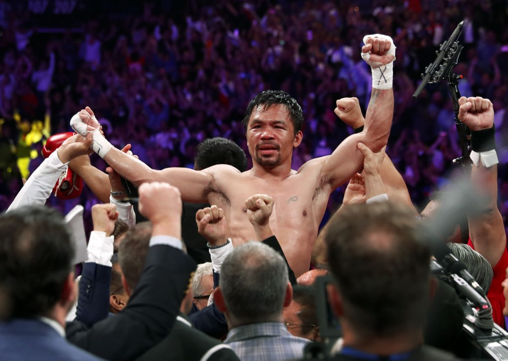 Pacquiao romps as oldest welterweight champ in history