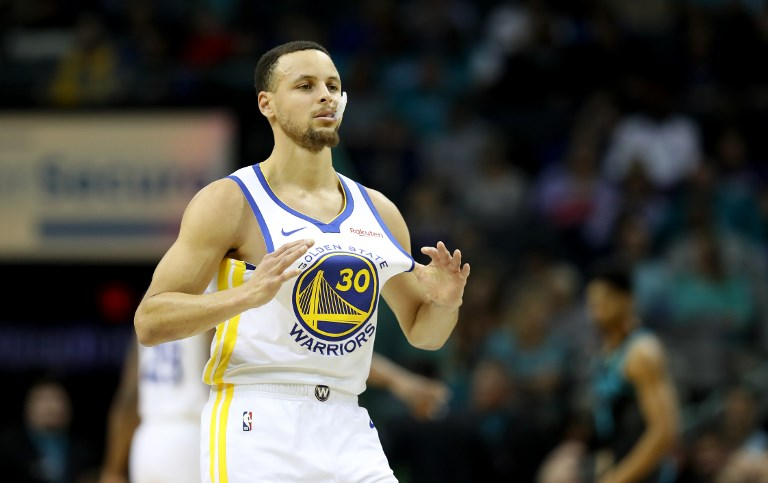 Curry sizzles late as Warriors drub Timberwolves