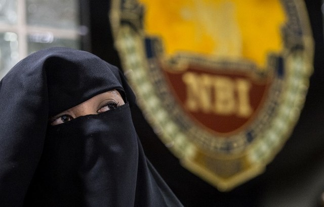 "CHARGED. Karen Aizha Hamidon is presented during a press conference at the National Bureau of Investigation (NBI) in Manila on October 18, 2017. Authorities arrested Hamidon who allegedly used the Internet and social media to recruit followers around the world for Islamist ""terrorist acts,"" government lawmen said. Photo by Noel Celis/AFP"