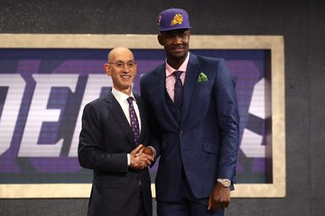 b223e6ce32e6 Deandre Ayton (right) poses with NBA commissioner Adam Silver after getting