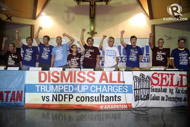 NDF CONSULTANTS. File photo of freed political prisoners raising their clenched fists during a press conference held shortly after their release in 2016. NDF consulant Rafael Baylosis (righmost) is among them. Photo by Ben Nabong/Rappler