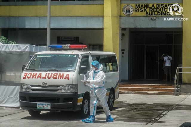 CORONAVIRUS. Workers wear Personal Protective Equipment inside the Manila Disaster Risk Reduction Building in Delpan, Tondo on June 2, 2020. Photo by Dante Diosina Jr/Rappler