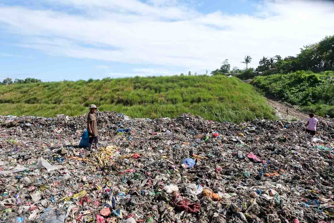 sanitary landfill A sanitary landfill is a pit with a protected bottom where trash is buried in layers, compacted (pressed down to make it more solid), and covered a sanitary landfill can reduce harm from waste that has collected, and is safer than an open dumping site.