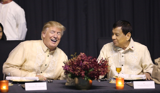 AMERICAN LEADER. US President Donald Trump sits beside Philippine President Rodrigo Duterte during the ASEAN gala dinner on November 12, 2017. ASEAN pool photo