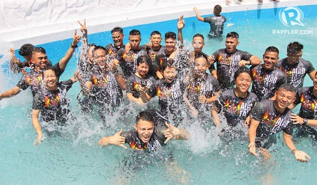 TRADITION. All graduating cadets of PMA are thrown into the pool by their yearlings or mentees a day before graduation. All photos by Mauricio Victa/Rappler