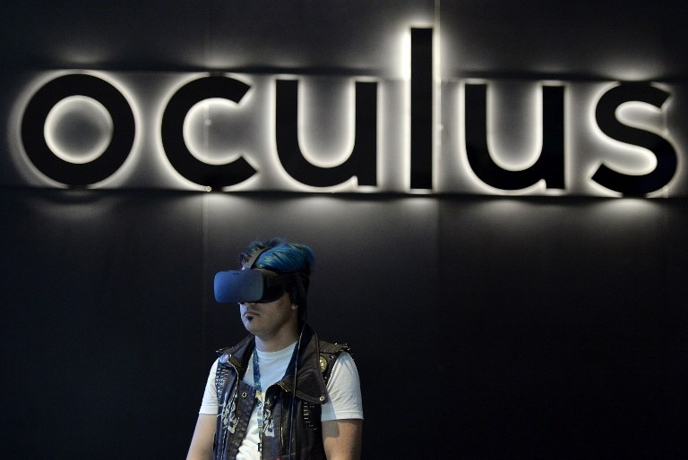 f98cb388c6f1 A gamer uses an Oculus Rift headset in the Oculus booth during the annual