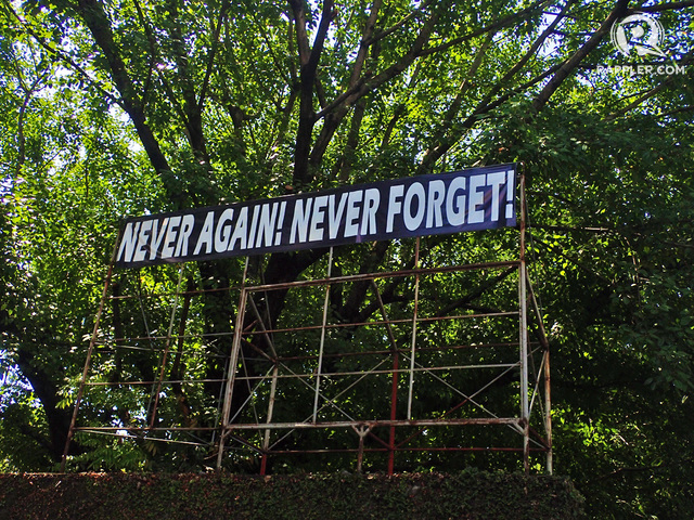 PROTEST. These words are visible among the trees as you walk deeper into Bantayog's compound.