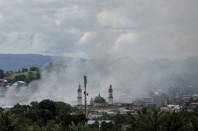 In this file photo, smoke rises after aerial bombings by Philippine Air Force planes on Islamist militant positions in Marawi, June 6, 2017. Noel Celis/AFP
