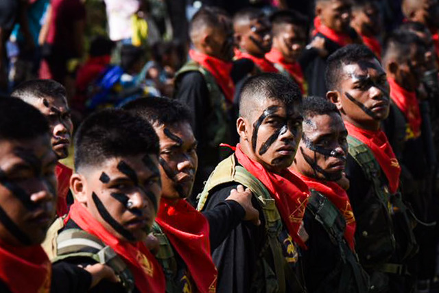 48 YEARS AND COUNTING. New Peoples Army guerrillas in Davao City during the 48th founding anniversary of the Communist Party of the Philippines on December 26, 2016. File photo by Edwin G. Espejo