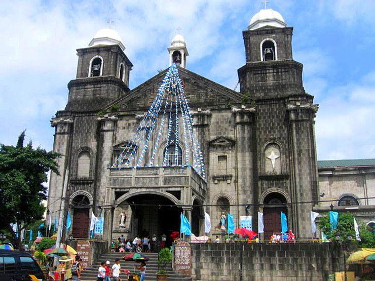TWIN DOMED TOWERS. Unique and easily noticeable in Tondo Church is its twin bell towers, and a third small bell tower on its roof. Photo from Sto. Niño de Tondo Church Facebook Page