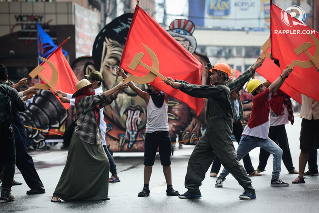 REDS. Anti-Duterte protesters posed with communist signs along Quezon Boulevard on Bonifacio Day, November 30, 2017. Photo by Maria Tan/Rappler