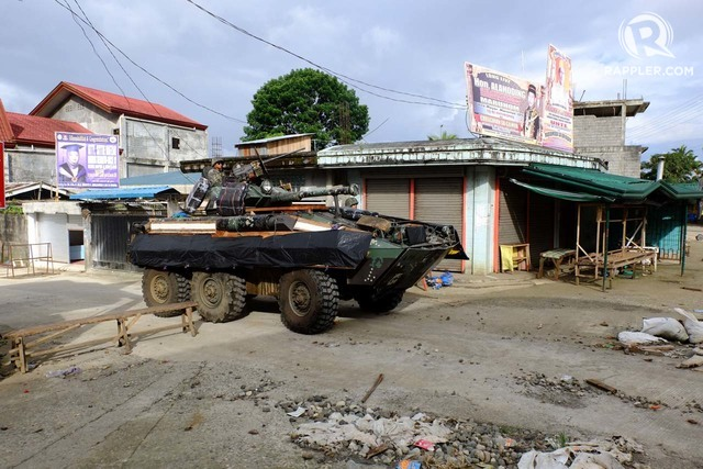 MARAWI CLASH. Using their V-300 Commando Fire Support Vehicle, the Philippine Marines patrol Barangay Saduc in Marawi City on June 6, 2017. Photo by Bbobby Lagsa/Rappler
