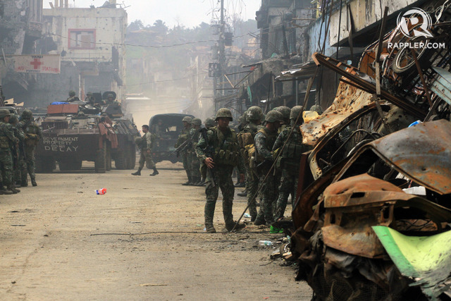 CRISIS IN MARAWI. In August 2017, a Marine Fire Support armored vehicle passes through the Mapandi district as it pulls out from the main battle area in Marawi City. File photo by Bobby Lagsa/Rappler