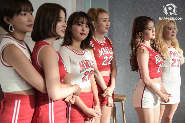 TEAMMATES. The group watches from the sidelines as Taeha shares a separate message to fans after the press conference.