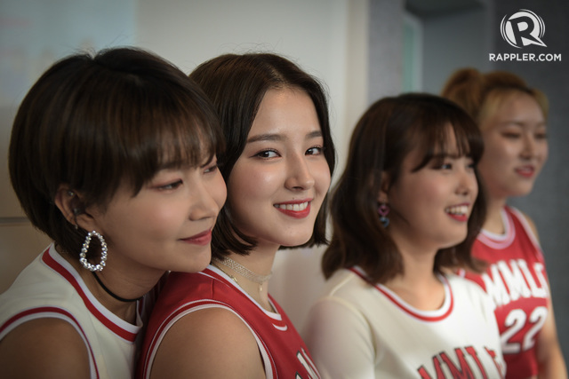 MOMOLAND. Hye Bin and Nancy share a moment alongside Ahin and Jane at their press event in Manila. All photos by LeAnne Jazul/Rappler