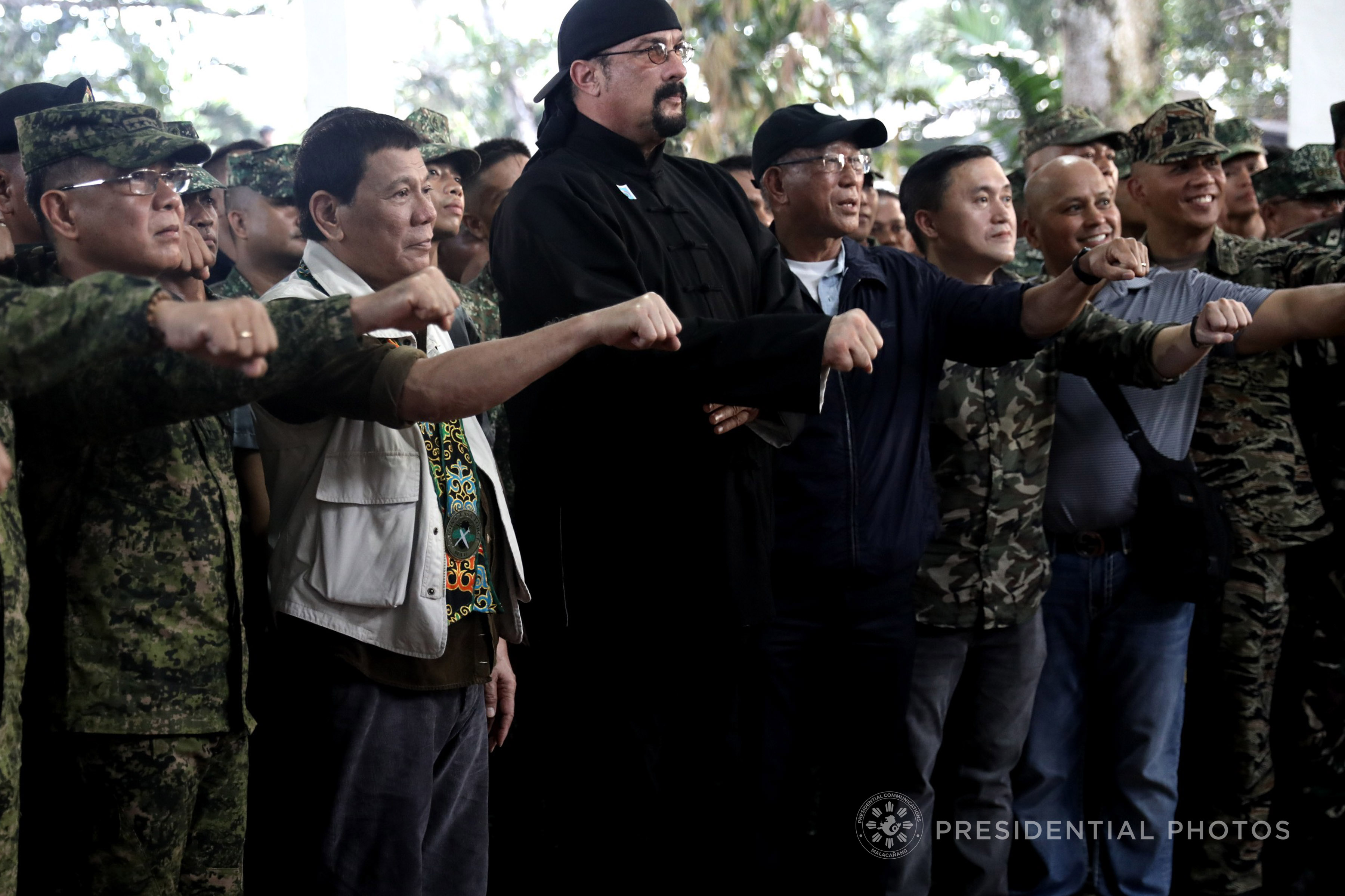 SPECIAL GUEST. President Rodrigo Roa Duterte flashes his signature pose with defense and military officials and his spcial guest,Hollywood actor Steven Seagal in a camp visit in Jolo, Sulu. Presidential Photo