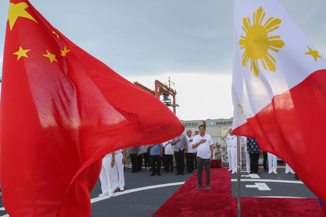 PUSHING THROUGH. The Philippines will not junk its plans to improve Pag-asa Island facilities, says President Rodrigo Duterte, who is shown here as he visited Chinese warships docked in Davao City on May 1, 2017. Malacañang photo