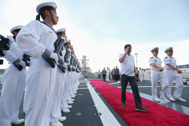 DUTERTE AND CHINA. Philippine President Rodrigo Duterte is given a tour inside the Chinese Navy vessel Chang Chun where he was able to see the armaments, the deck, the bridge navigation system, and operations room command and control system. Malacañang file photo